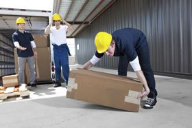 Occupational Health Services & Assessments of man lifting a box