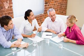 4 people in a meeting about work rehabilitation