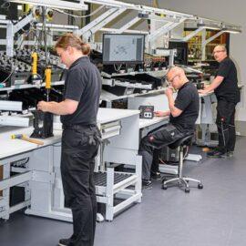 men doing tasks at ergonomic workstations