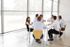 people using meeting room chairs